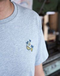 Light blue men's t-shirt with a tropical embroidery