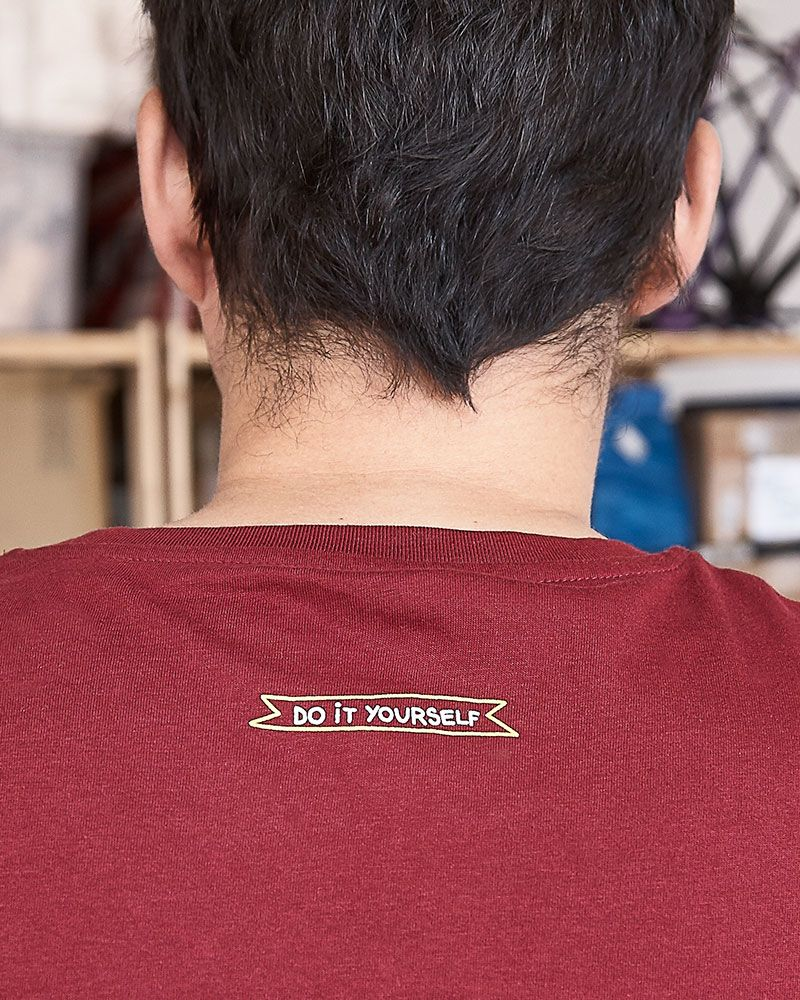 "Maroon men's t-shirt with a ""Do It Yourself"" embroidery."