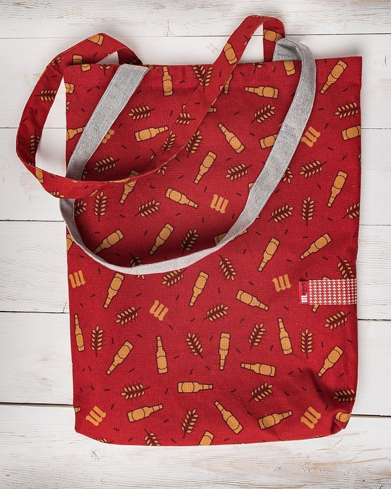 Red beer bottle pattern totebag made forMahou by peSeta. Simple and original two handle bag.