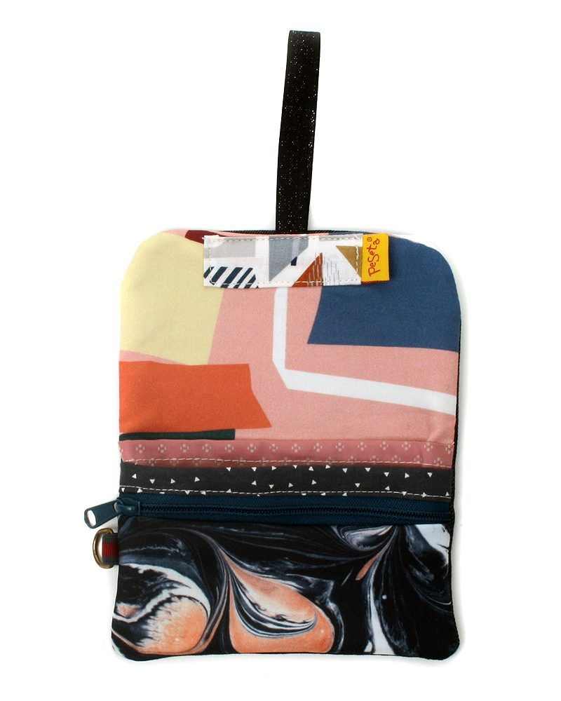 Printed passport case with colorful collage pink pattern by artist Luján Marcos. Outside, marbled pattern created by illustrator Brianda Fitz-James Stuart.