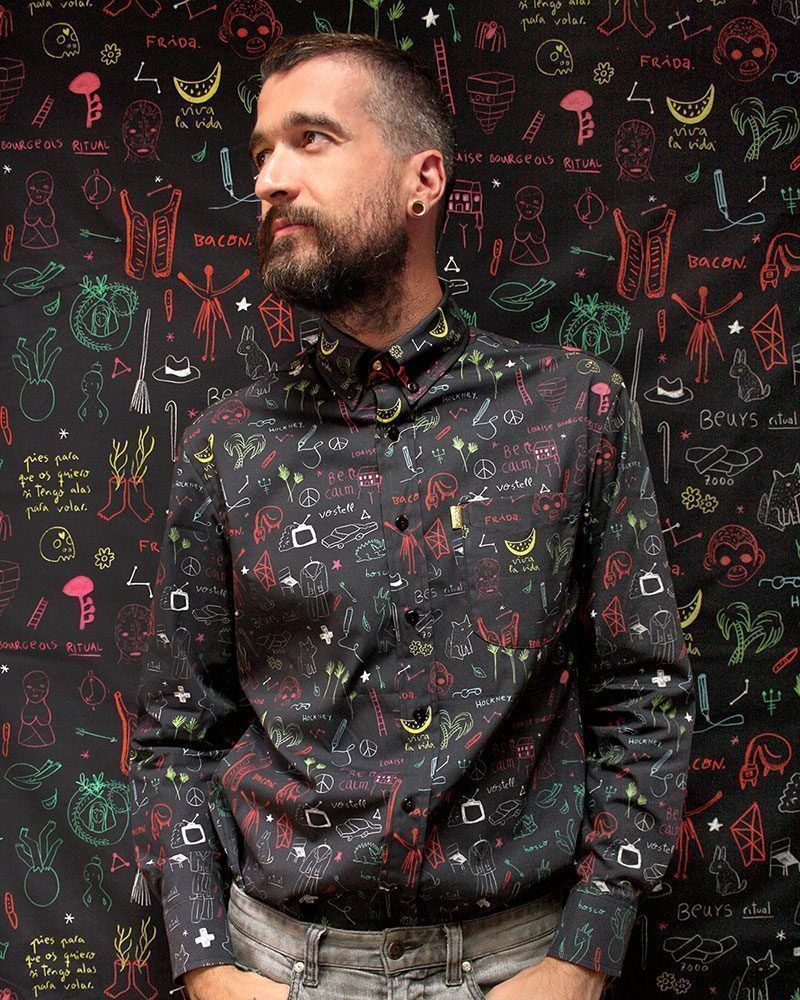 Black long sleeve men shirt. Pattern designed by peSeta from drawings by artist Aitor Saraiba.
