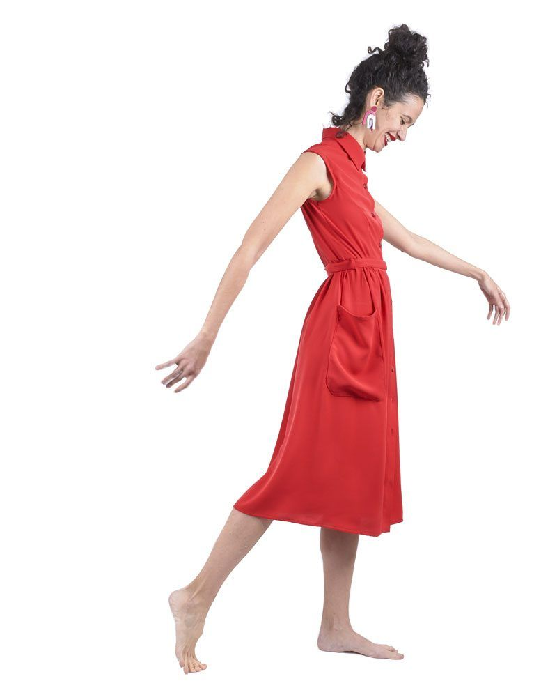 Red button midi dress. No sleeves, youthful silhouette that falls to above the ankle.