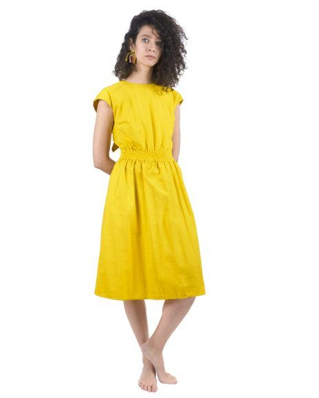 Open back yellow dress with a knot.